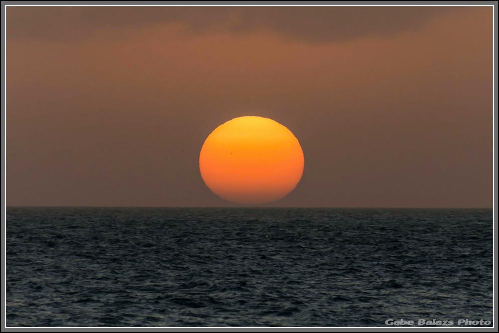 IMAGE: http://gabebalazsphoto.com/misc_photos/sigmasunset1.jpg